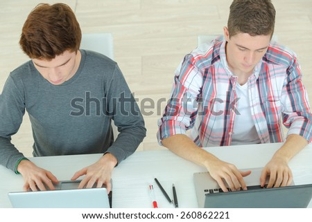 Two guys studying