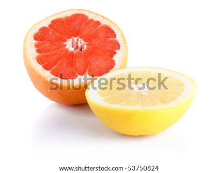 Two half of red end yellow grapefruits isolated on white background