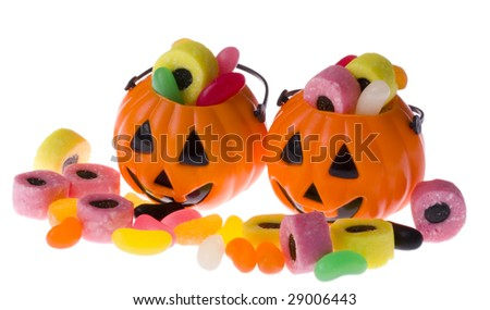 Two Halloween pumpkin heads filled with treats - stock photo