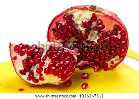 Two halves of a pomegranate  on white background