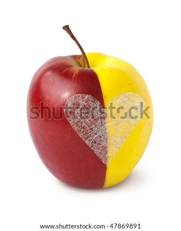 Two halves of apples merged together as a whole with silver heart on white background (Clipping path included). - stock photo