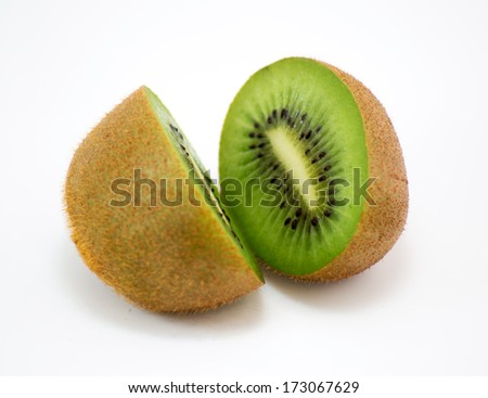 Two halves of kiwi isolated on white background