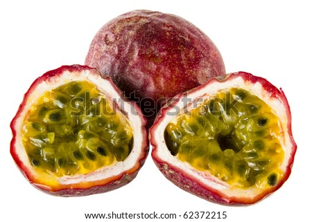 two halves of passion fruit an a whole one
