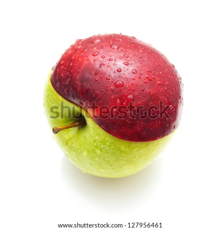 Two halves of red and green apple connected on a white background. - stock photo