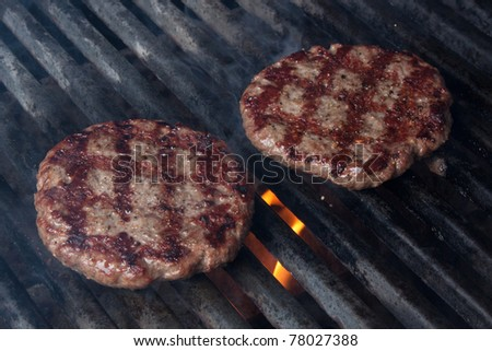 Two Hamburgers on Barbeque Grill - stock photo