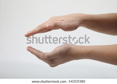 two hand form a protection shield - stock photo