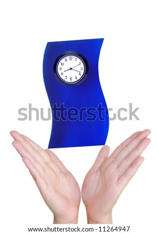 Two hand holding a clock for timing handle with care concept - stock photo