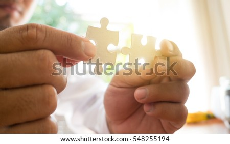 two hand holding connecting piece jigsaw puzzle, Business connection, success and strategy concept.
