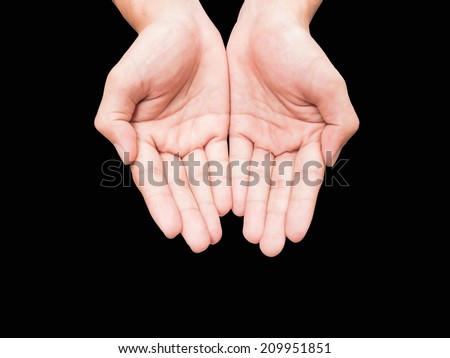 Two hand holding or offering something isolated on black background