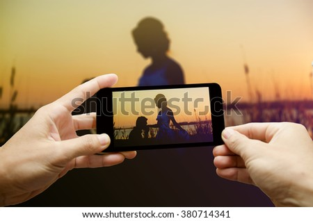Two hand holding smartphone - stock photo