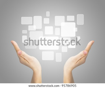 Two hand holding touch screen on gray background - stock photo
