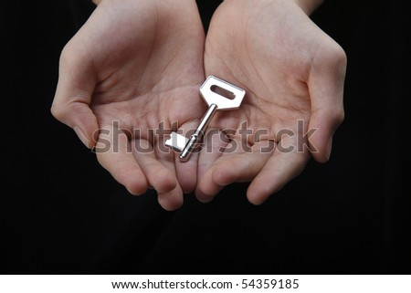 two hand open showing a key - stock photo