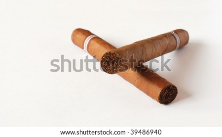 Two Hand Rolled Cuban Cigars - stock photo
