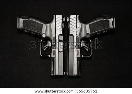 two handgun on the black background - stock photo