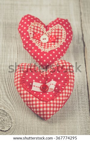 Two Handmade hearts on white wooden backround. Vintage soft colours
