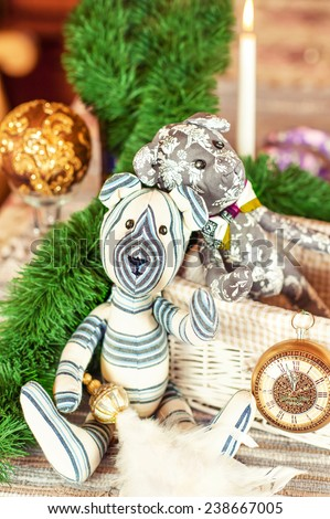 Two handmade provence tilda Teddy bear toys on christmas background. Celebration gift. Indoors still-life. - stock photo