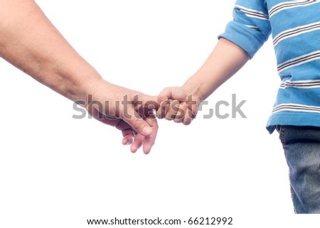 Two hands - adult and child - stock photo
