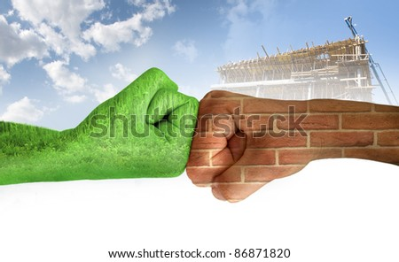 Two hands against each other. Green hand with grass and brick wall hand. Confrontation environment against construction industry. Ecology - stock photo