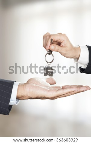 Two hands and a key - stock photo