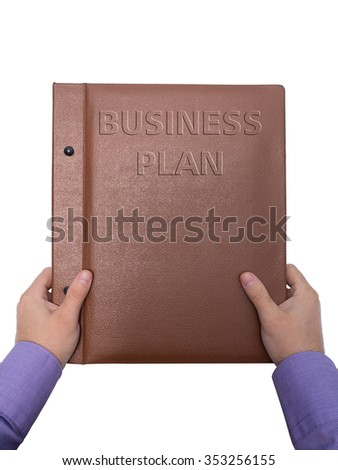 Two hands and book business plan isolated on white background - stock photo