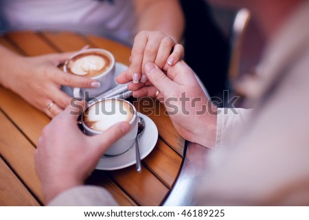 two hands and cup of coffee - stock photo