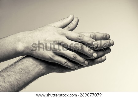 Two hands (attention and tenderness) - stock photo