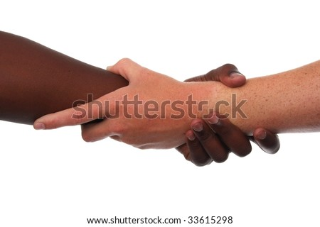 Two hands, black and white, in a strong clasp - stock photo
