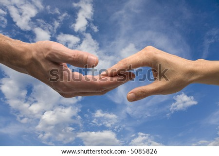 Two hands contact on blue sky with clipping path - stock photo