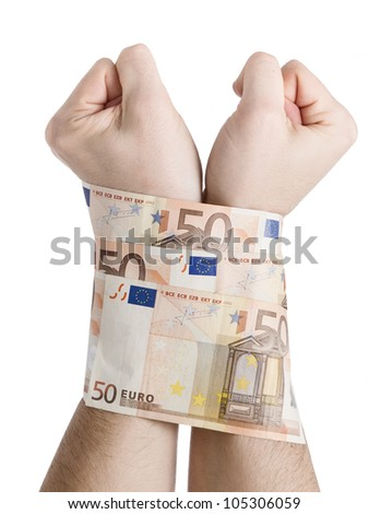 Two hands cuffed by 50 euros. The picture is intended to convey the concept of the global economic crisis we are experiencing the pressure as well as markets and banks over the population - stock photo