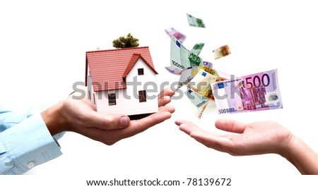 Two hands exchange money with house