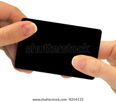 Two hands exchanging a blank card - this can be a business card, a gift card, or even a credit card - just to name a few different options.  Use your imagination! - stock photo