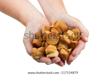 """two hands filled with typical dutch """"pepernoten"""" - stock photo"""