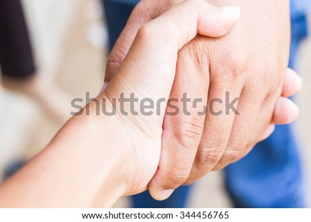 Two hands (helping hand to a friend) - stock photo