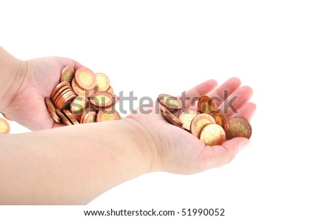 Two hands hold shiny coins - stock photo