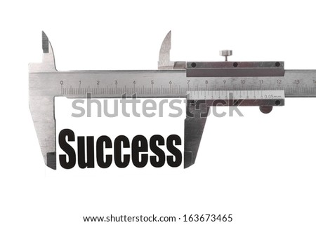 """Two hands holding a caliper measuring the word """"Success"""". - stock photo"""
