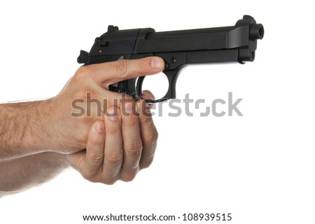 Two hands holding a gun with finger off the trigger on a white background - stock photo