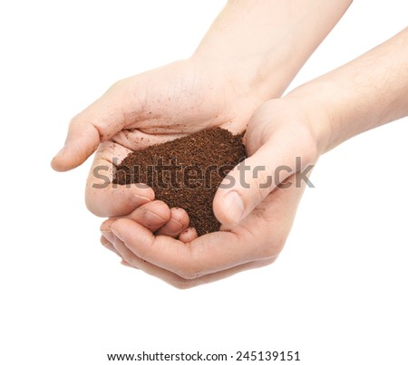Two hands holding a handful of ground soil, composition isolated over the white background - stock photo