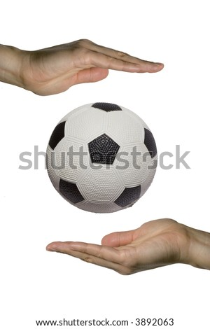 two hands holding a soccer ball (vertical)