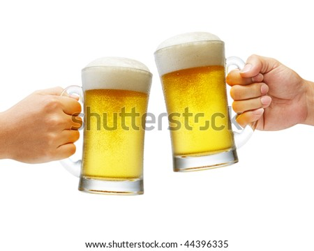 two hands holding beers making a toast - stock photo