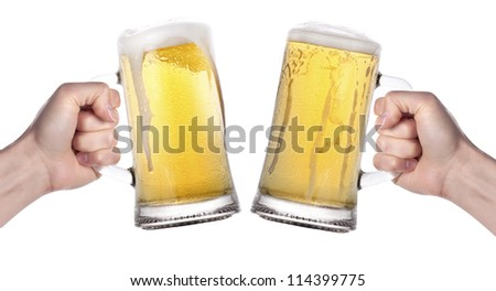 two hands holding beers making a toast isolated on a white background - stock photo