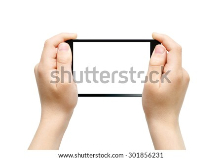 Two hands holding big fablet, playing games, clipping path - stock photo