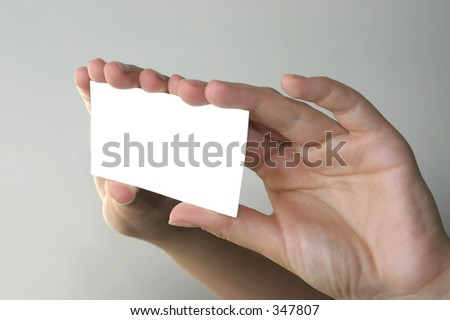 two hands holding blank business card