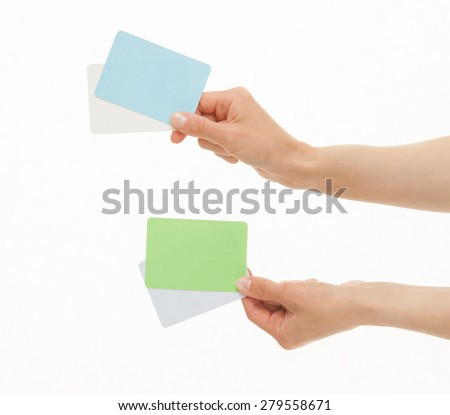 Two hands holding colorful paper cards, white background