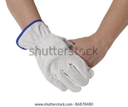 two hands holding each other, one gloved with a light grey working glove.Studio shot in white back