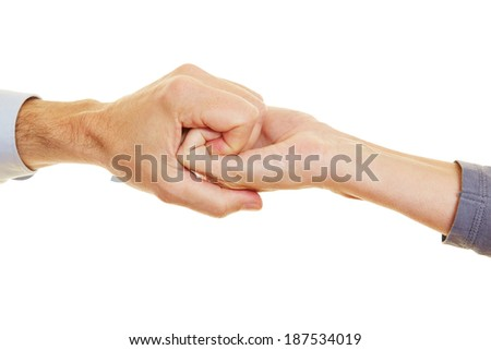 Two hands holding each other to form a spiral
