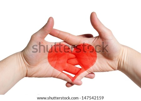 two hands holding each other with a heart inbetween, symbolizing love and relationship - stock photo