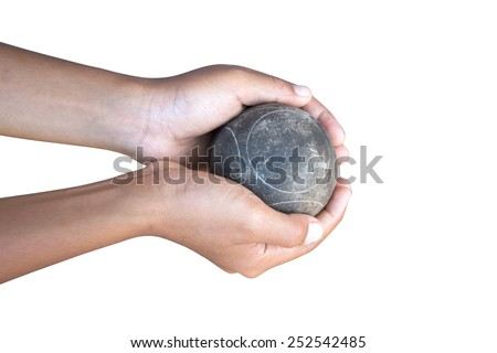 Two hands holding petanque balls - stock photo