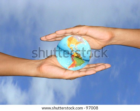 Two hands holding the world - stock photo
