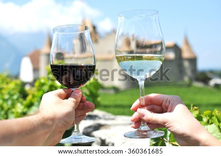 Two hands holding wineglasses, Switzerland - stock photo