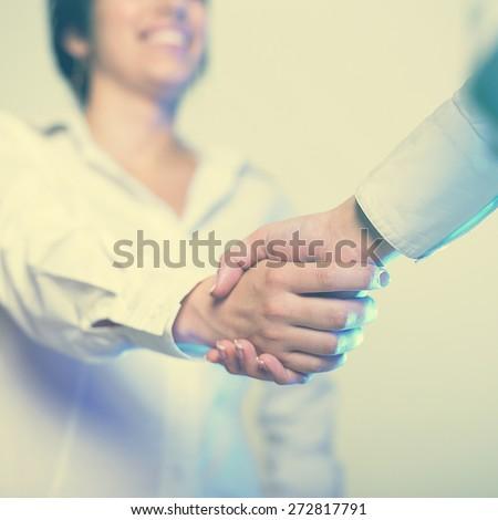 Two hands in Handshake - Business Handshaking - stock photo